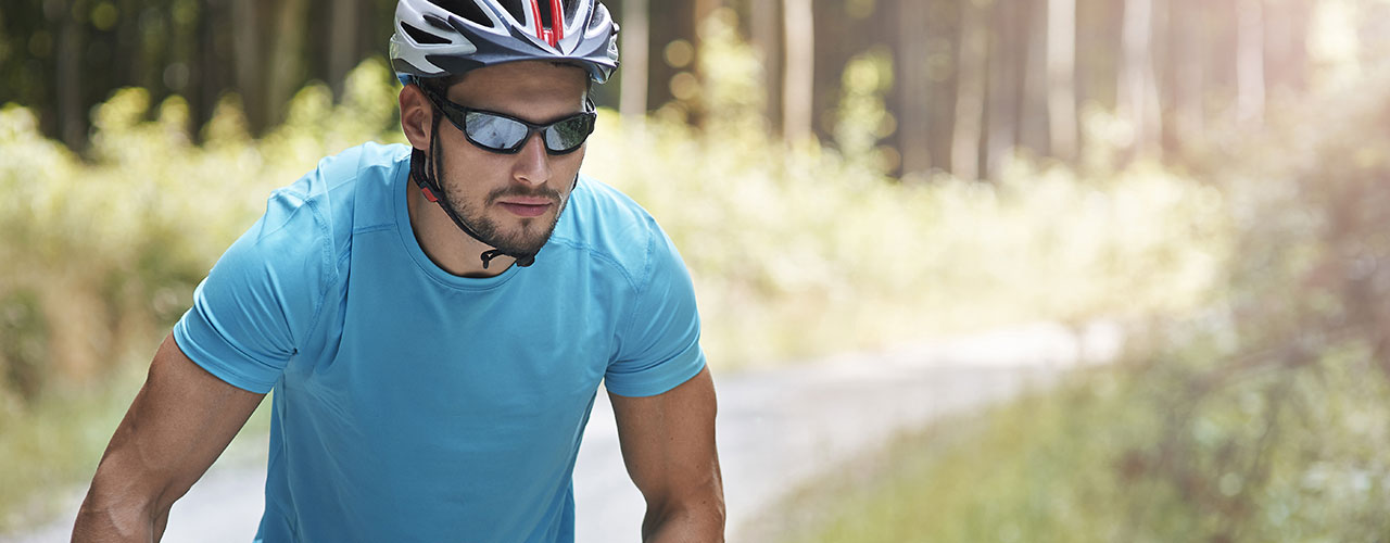 man riding bike with sunglasses