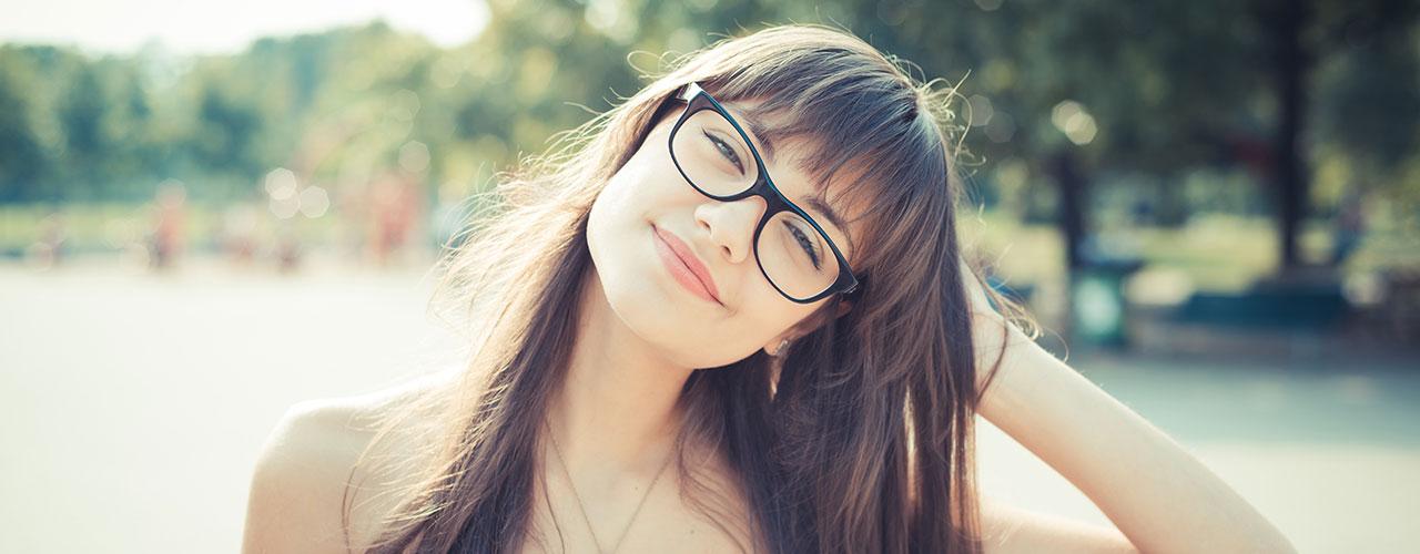woman outsides wearing eyeglasses